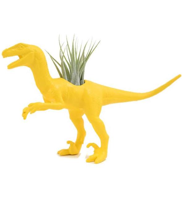 Vélociraptor jaune avec plante